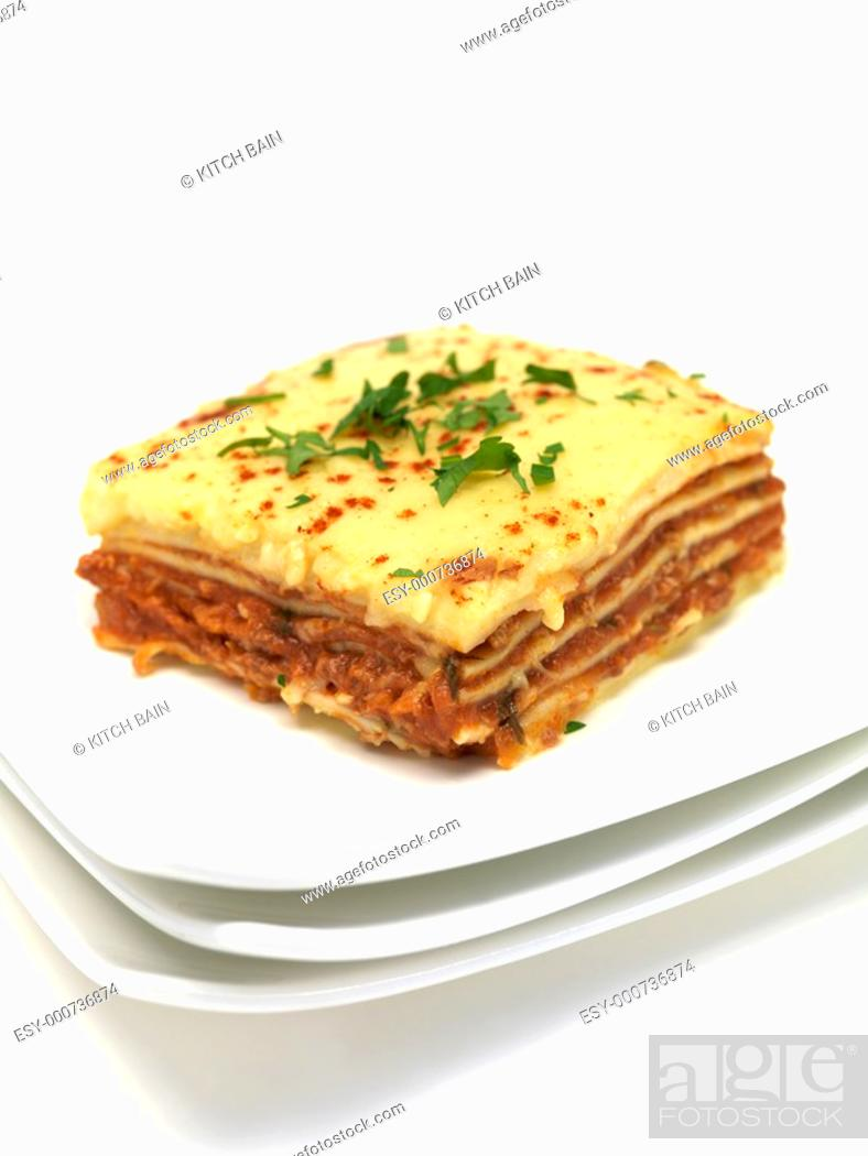 Stock Photo: Lasagne plated up and isolated against a white background.