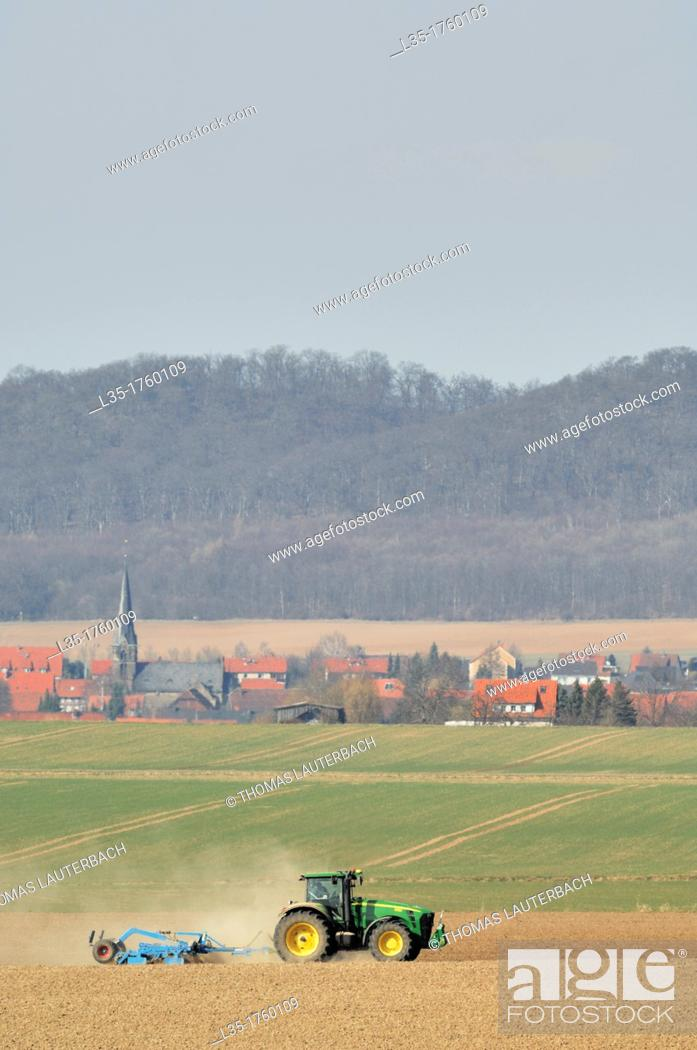 Stock Photo: heavy tractor working on a field in Lower Saxony, Germany, near Goslar.
