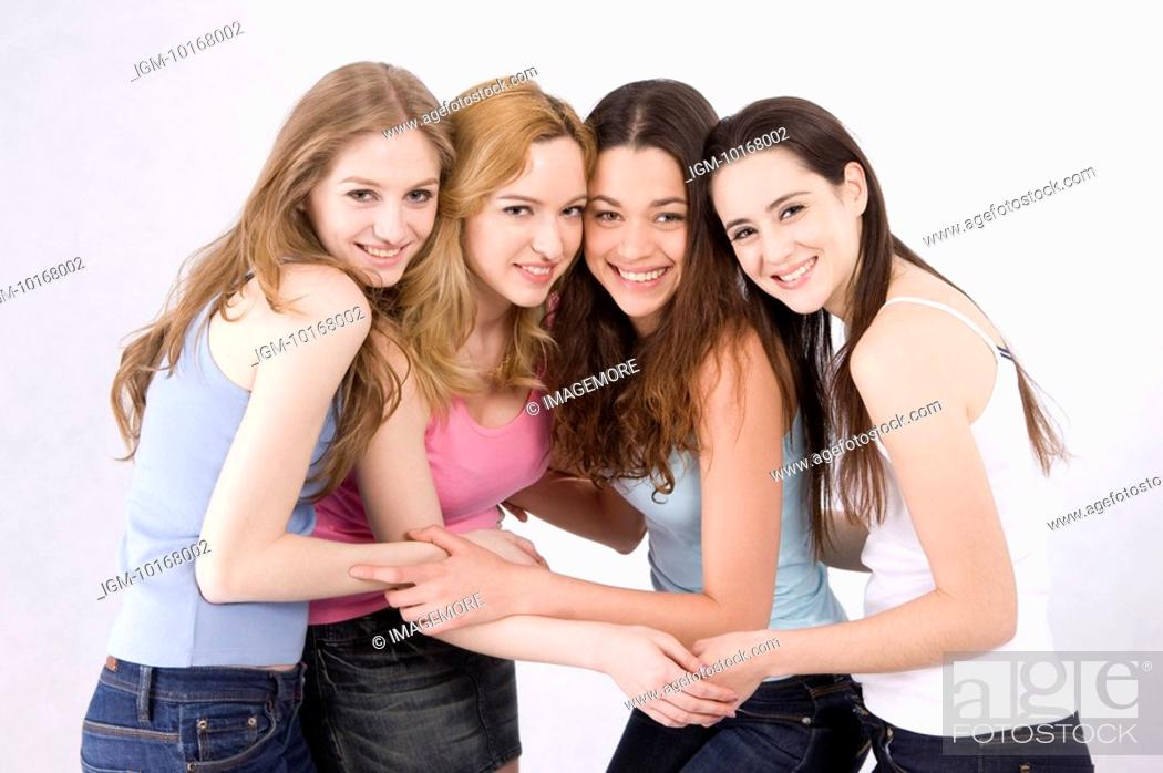 Stock Photo: Four women standing together, holding hands.