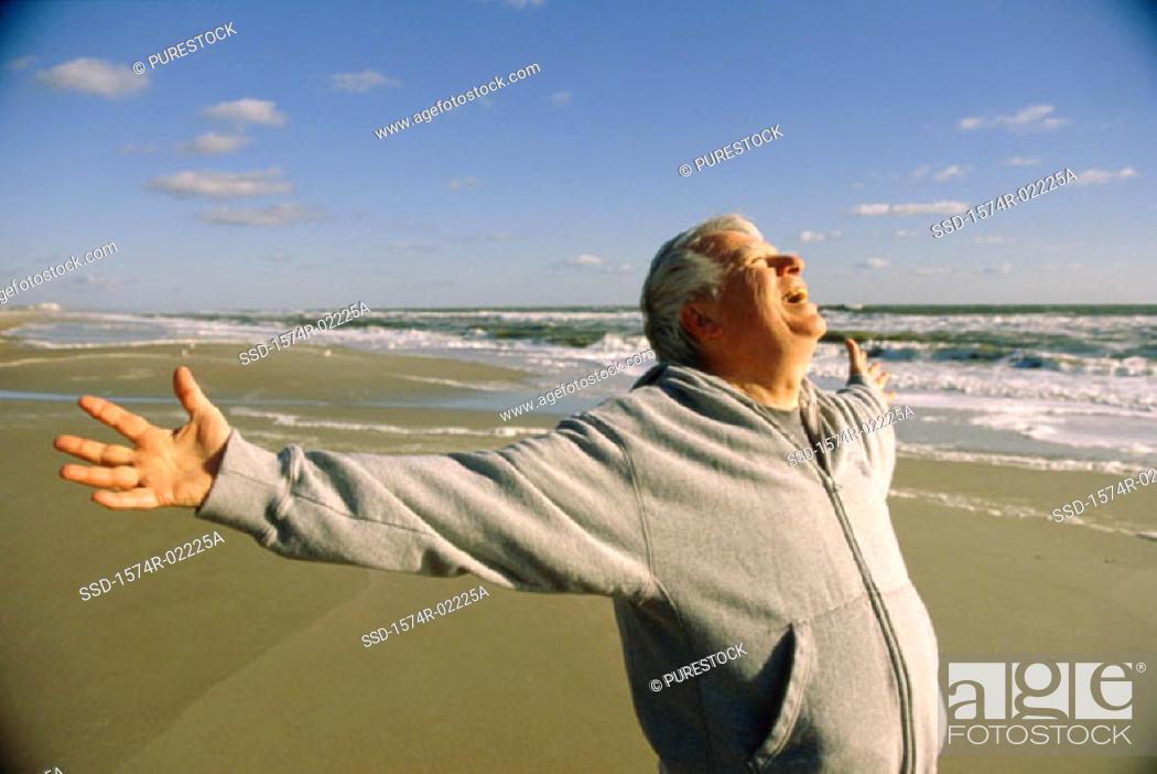 Stock Photo: Senior man exercising on the beach.