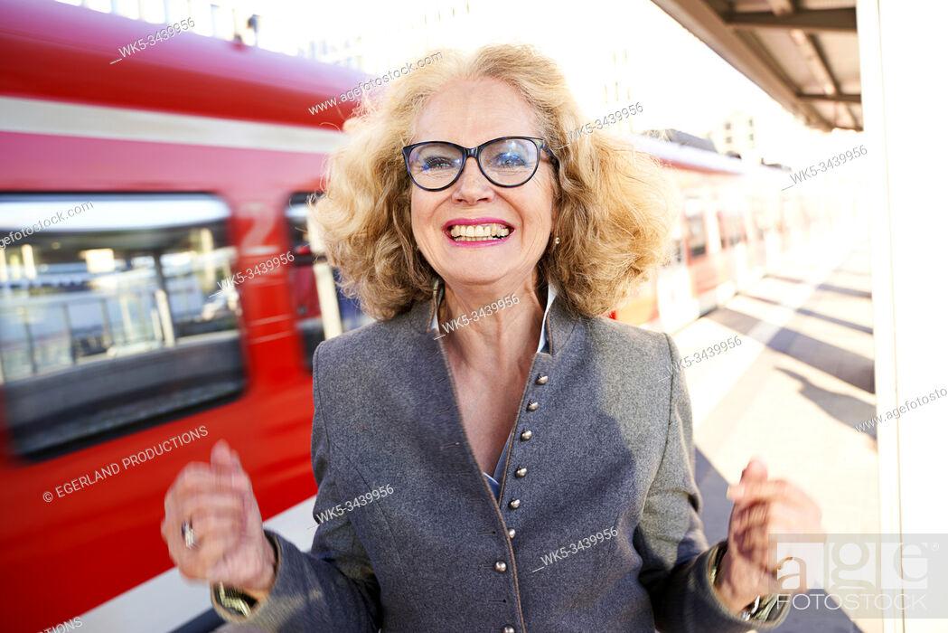 Stock Photo: Bavarian senior woman in S-Bahn station. Munich, Germany.
