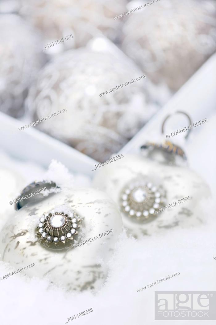 Stock Photo: Silver christmas ornaments, Close-up, Germany.
