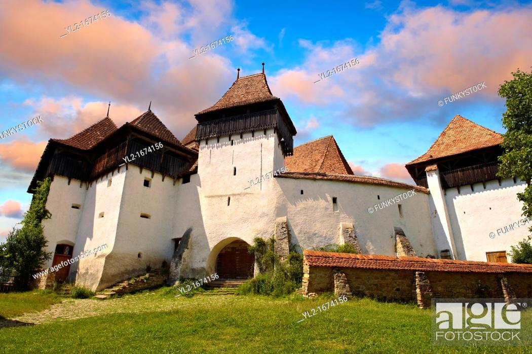 Stock Photo: Front view of the Szekly medieval fortified church of Viscri, Bunesti, Brasov, Transylvania. Started in the 1100's. UNESCO World Heritage Site.