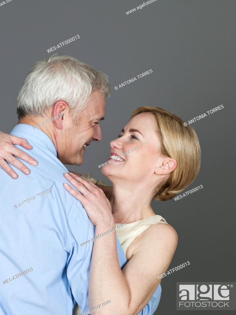 Stock Photo: Mature couple embracing each other, smiling.