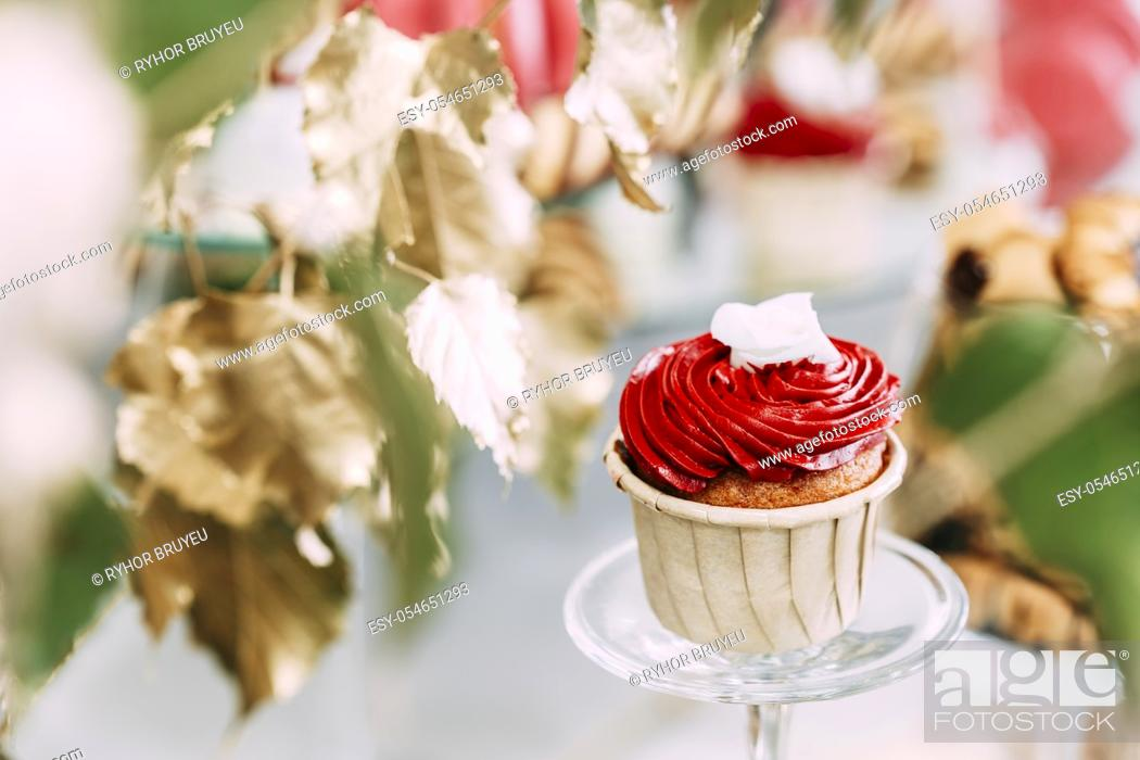 Stock Photo: Dessert Sweet Tasty Cupcake In Candy Bar On Table. Delicious Sweet Buffet. Wedding Holiday Decorations.