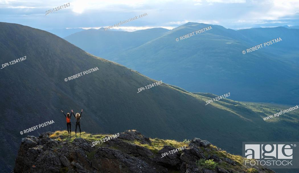 Stock Photo: Two women exploring the mountains and wilderness of the Yukon. Feeling alive and vibrant in the beautiful scenery around Haines Junction; Yukon, Canada.