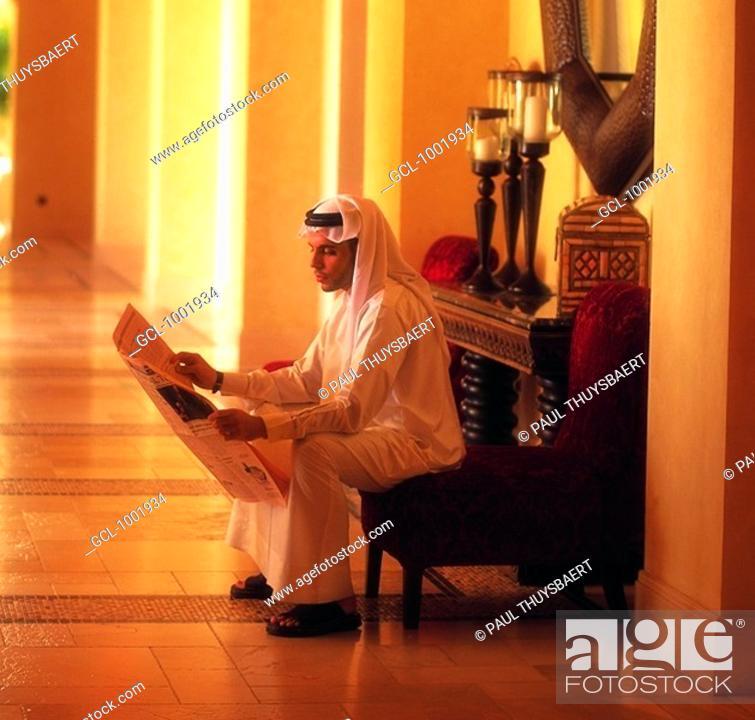 Stock Photo: Arab businessman reading the newspaper.