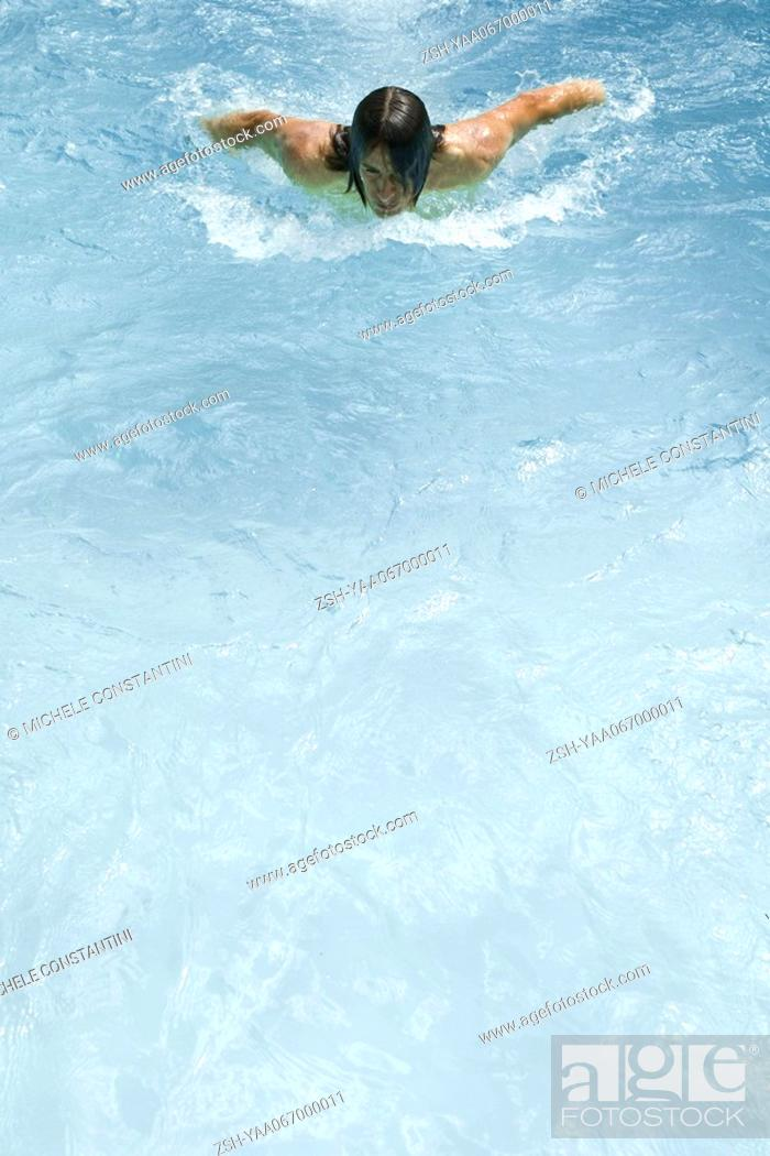Stock Photo: Man swimming in pool, high angle view.