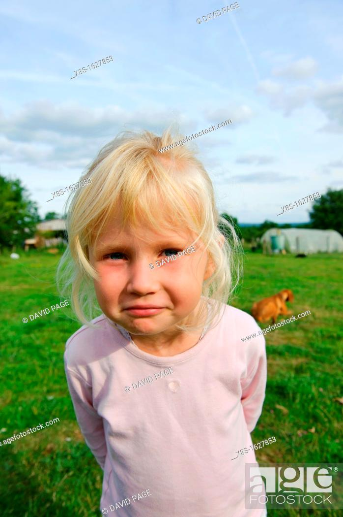 Stock Photo: Stock photo of a 6 year old girl outside in the garden.