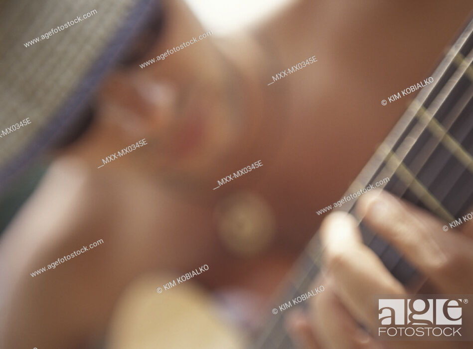 Stock Photo: Blurred portrait of man playing Guitar.