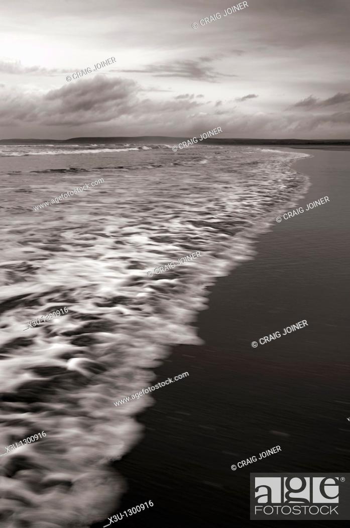 Stock Photo: Incoming wave on the beach at Westward Ho! on the North Devon coast, England, United Kingdom.