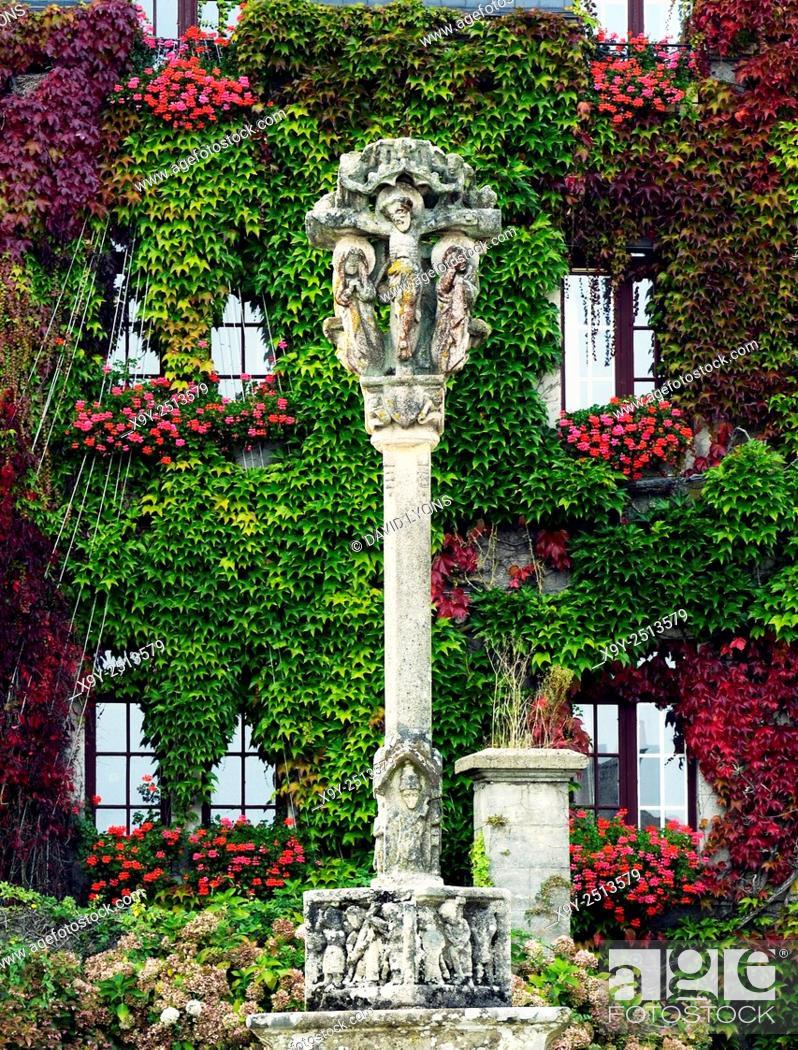 Stock Photo: 16th C Breton calvaire cross. Church square of Eglise Notre Dame de la Tronchaye. Rochefort en Terre, Morbihan, Brittany, France.