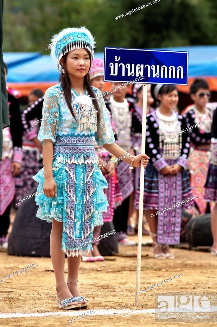 Stock Photo: Young Hmong women, traditionally dressed, take part in a new year festival parade at Hung Saew village, Chiang Mai, Thailand, Asia.
