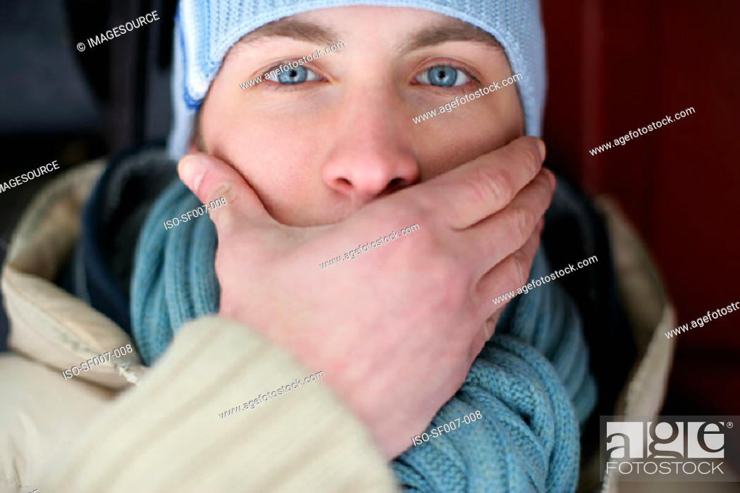 Stock Photo: Man covering his mouth.