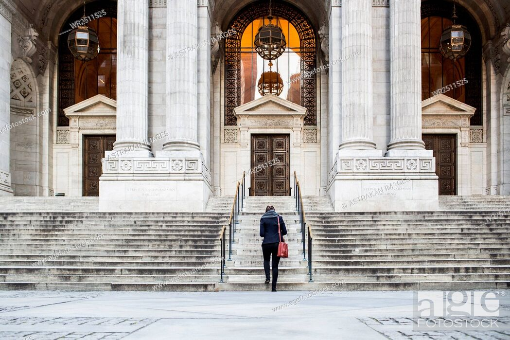 Stock Photo: Rear view of businesswoman walking towards New York Public Library.