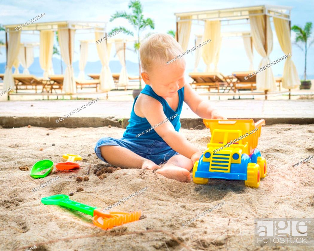 Stock Photo: Cute baby is playing toy car.