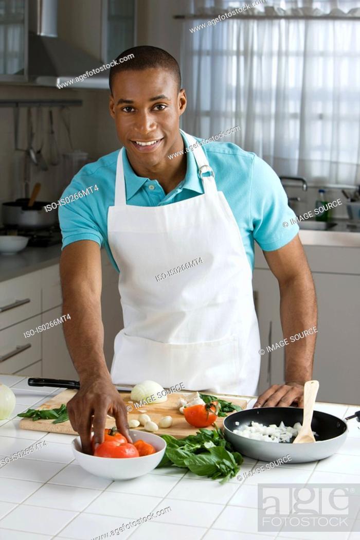 Stock Photo: A man preparing a meal.