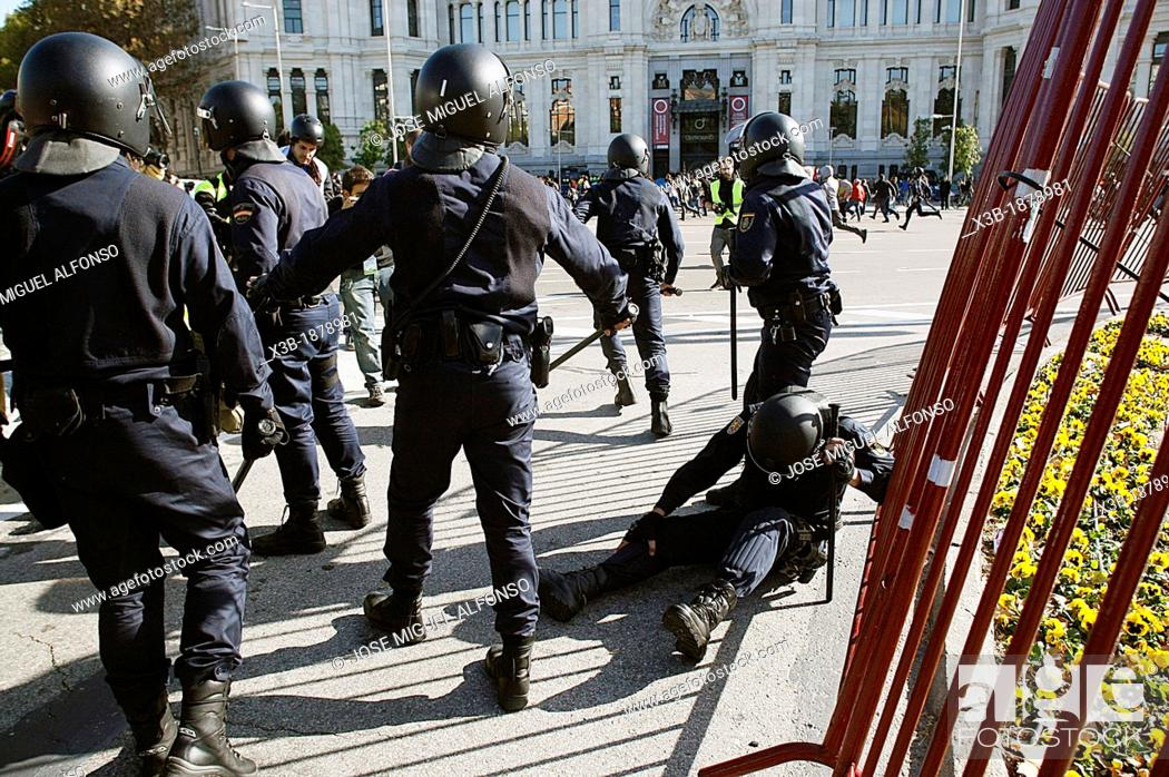 Stock Photo: Police injured in riots during the general strike on November 12, 2012 in Madrid, Spain.
