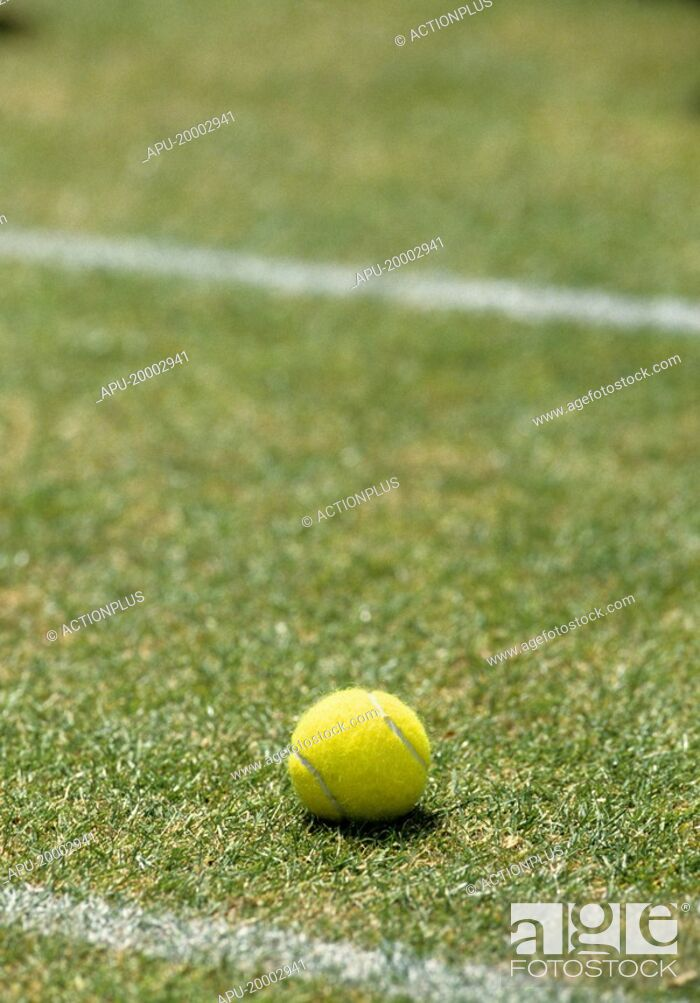 Stock Photo: Tennis ball on a grass court.