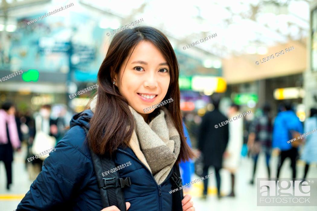 Stock Photo: Woman at train station.