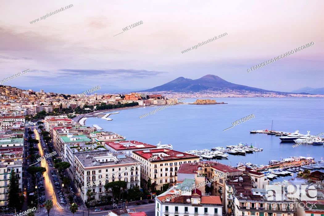 Stock Photo: Naples, Campania, Italy. View of the bay by night and Mount Vesuvius Volcano in background.