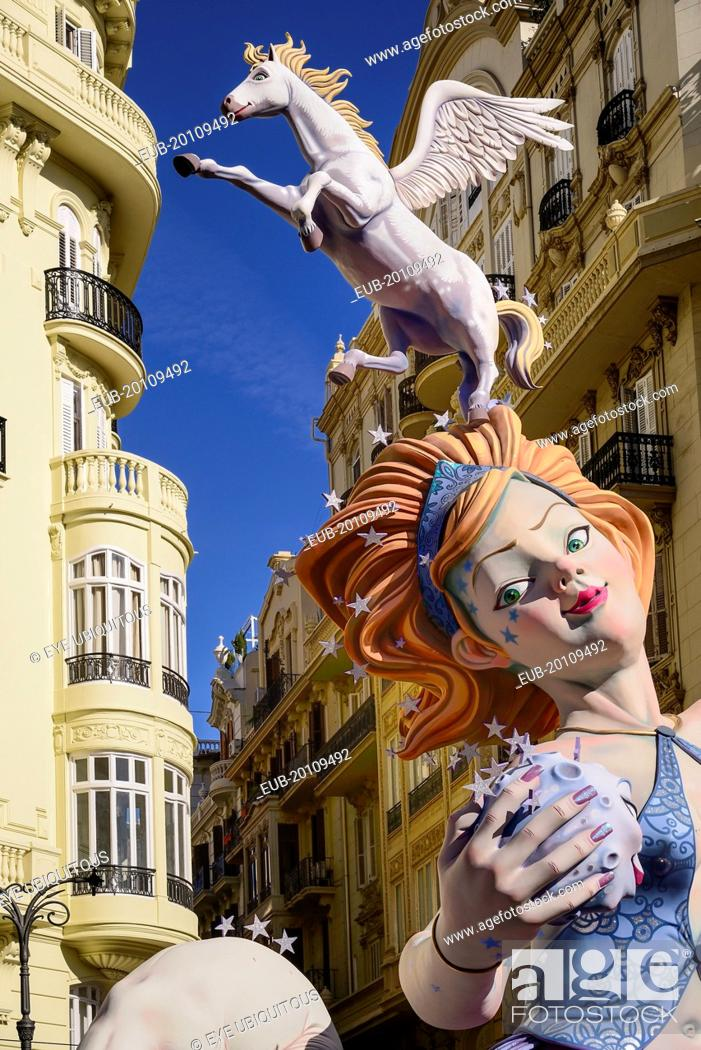 Photo de stock: Female Papier Mache figure with a horse on her head in the street during Las Fallas festival.
