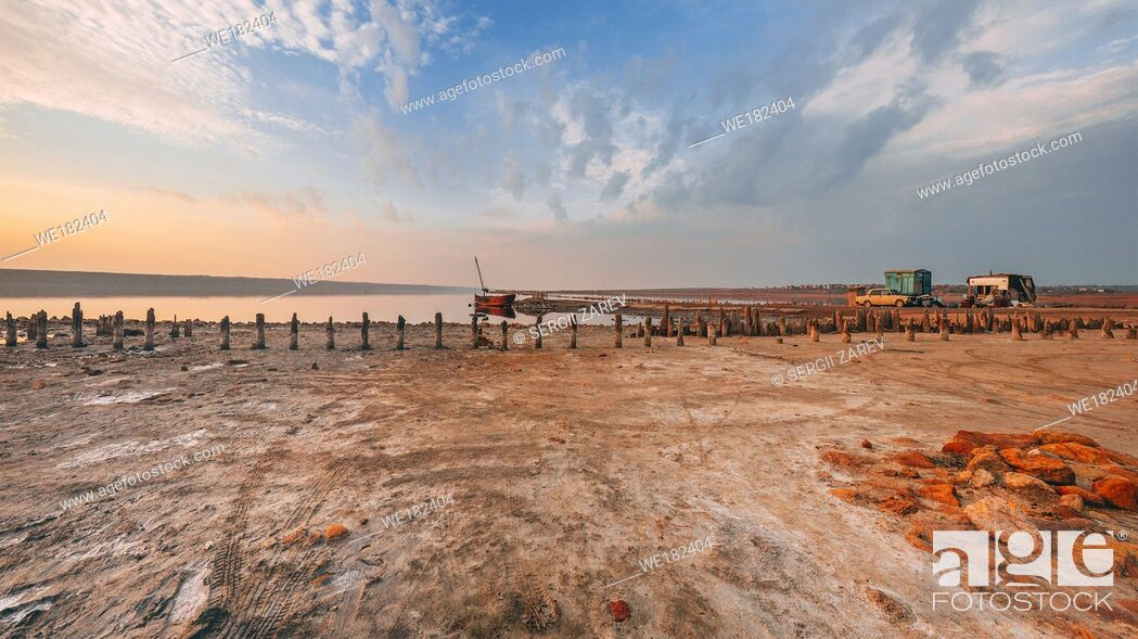 Stock Photo: Shore and bottom of a drying lake at sunset.