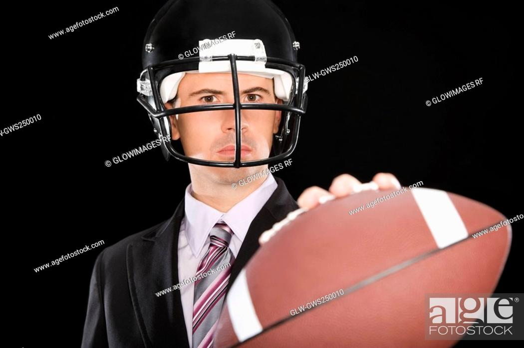 Stock Photo: Close-up of a businessman wearing a football helmet.