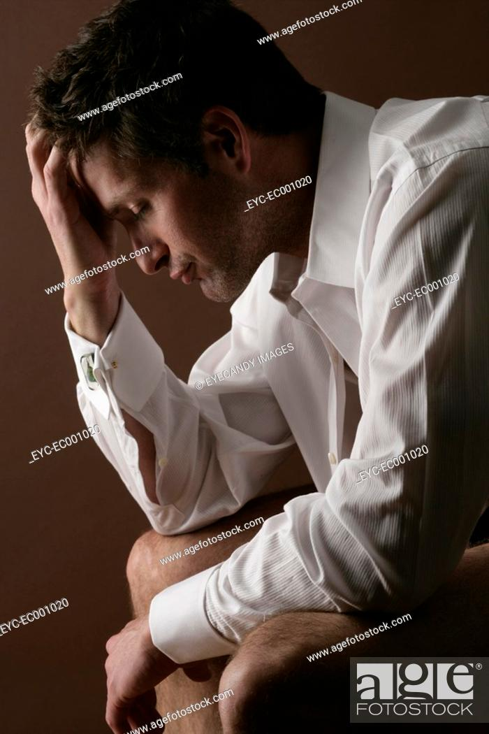 Stock Photo: Portrait of a thoughtful man.