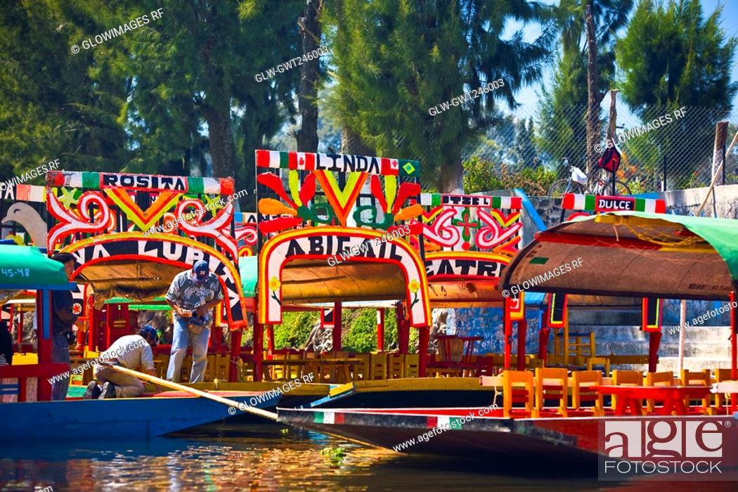 Stock Photo: Two men on a trajineras boat, Xochimilco Gardens, Mexico City, Mexico.