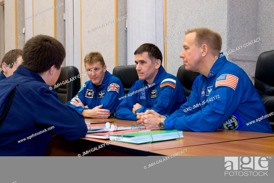 Stock Photo: At their Cosmonaut Hotel crew quarters in Baikonur, Kazakhstan, Expedition 46-47 crewmembers Tim Peake of the European Space Agency (left).