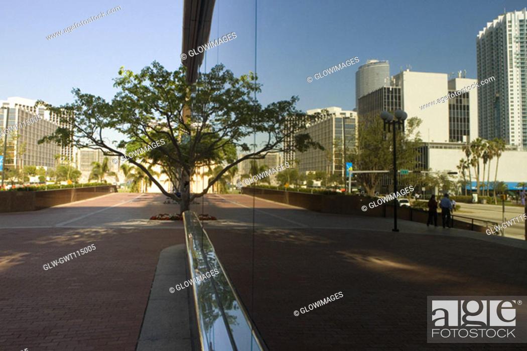 Stock Photo: Reflection of buildings on glass, Miami, Florida, USA.