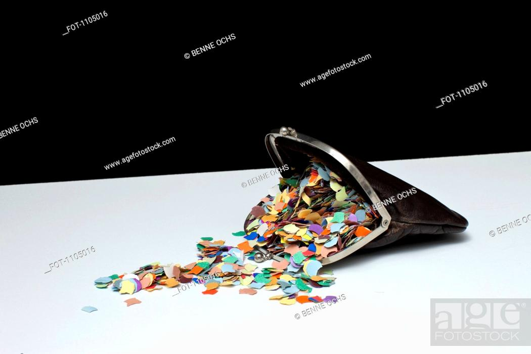 Stock Photo: Confetti spilling out of a coin purse.