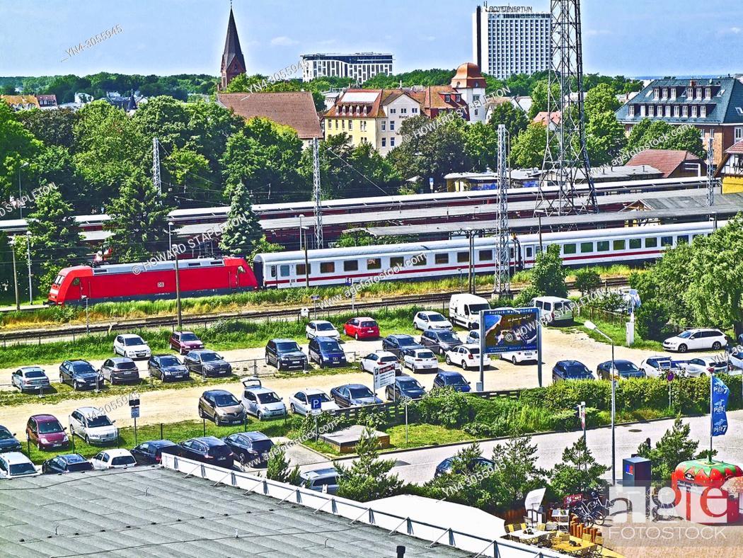 Stock Photo: Warnemünde, Germany, Train station and city.