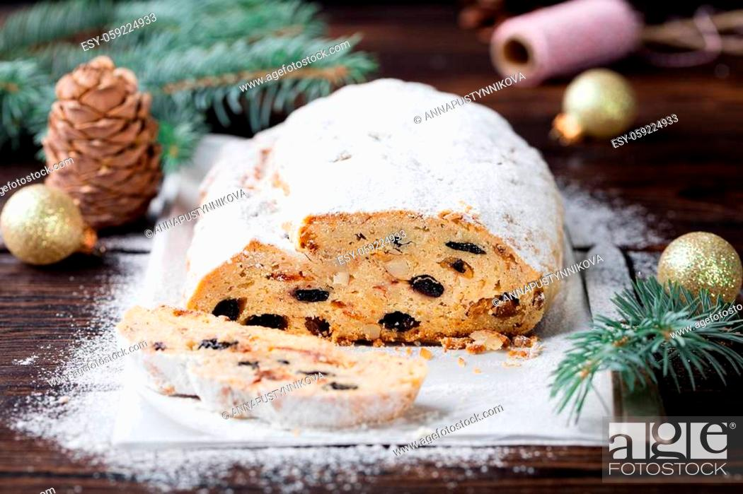 Stock Photo: Christmas stollen cake with icing sugar. Traditional Dresdner christ pastry with marzipan and raisins. Close up.