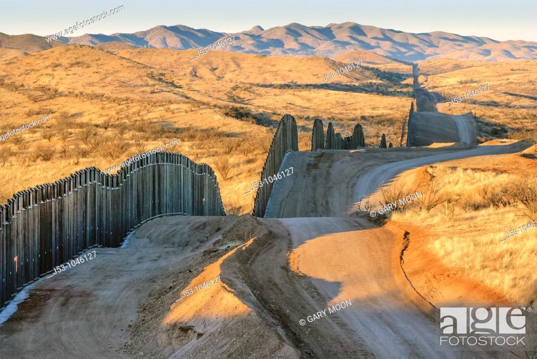Stock Photo: United States border fence, US/Mexico border, Nogales, Arizona USA.
