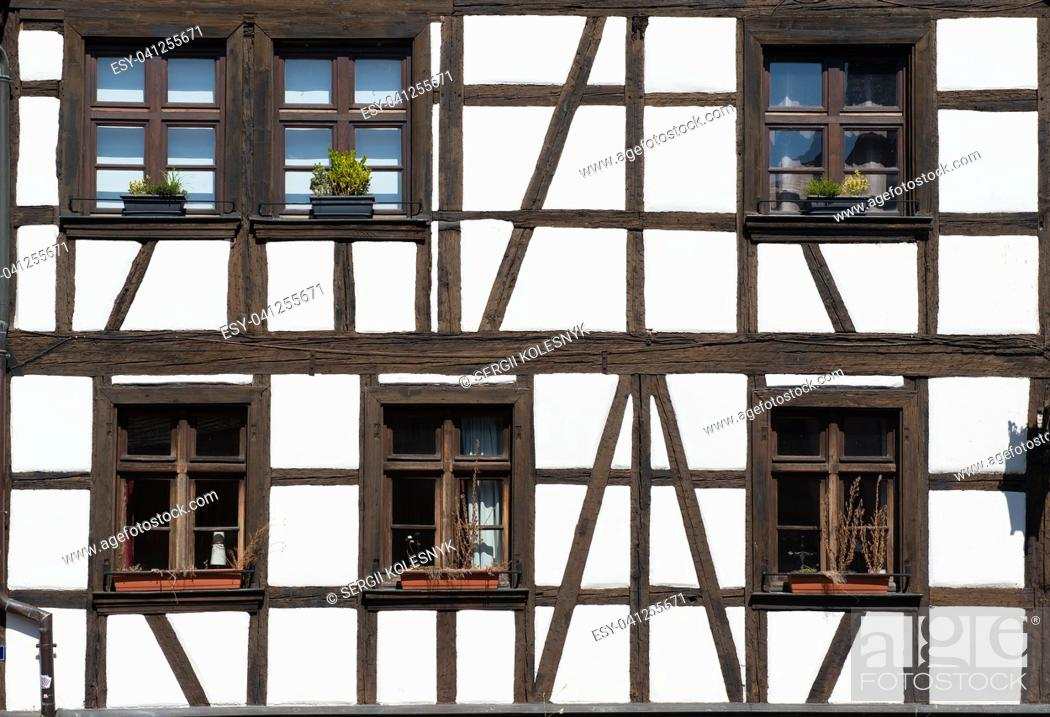 Stock Photo: Wall and windows of traditional old house in Strasbourg, France.