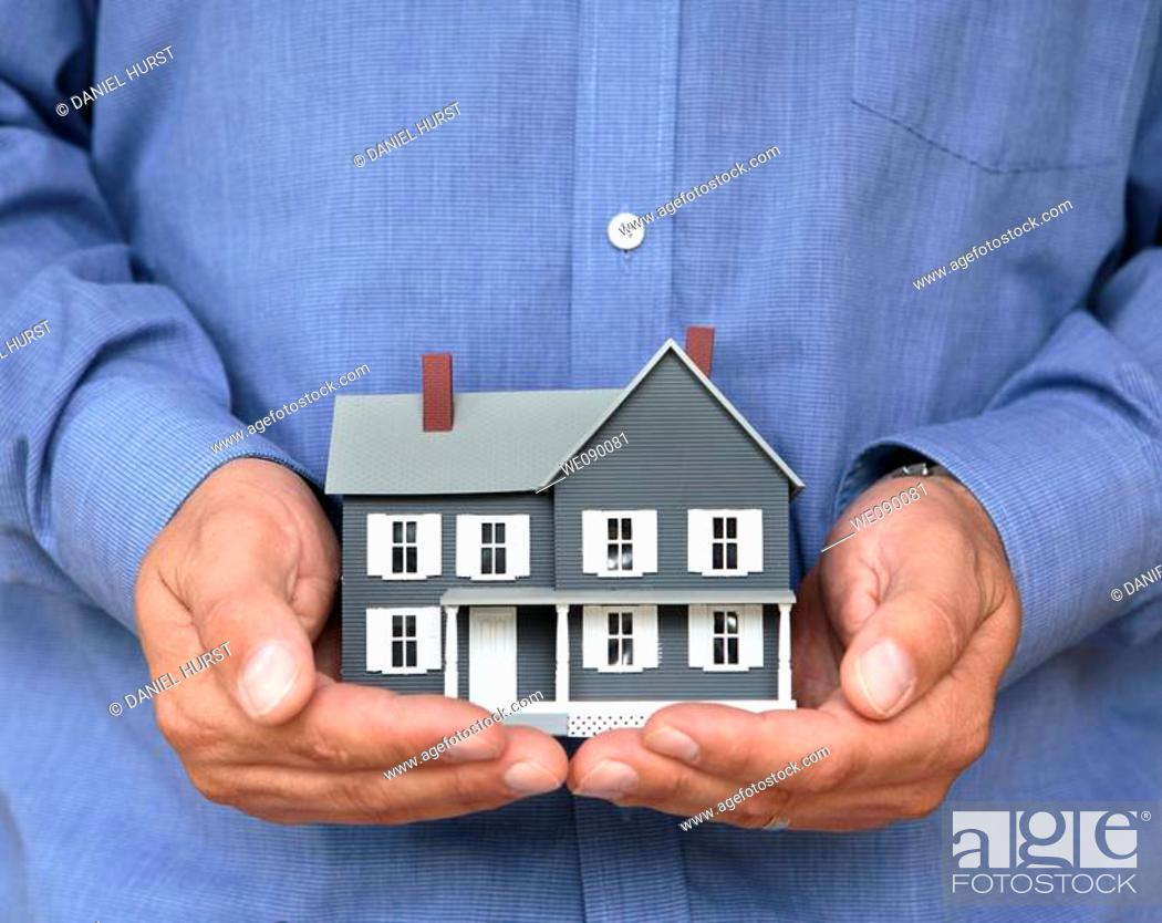Stock Photo: House in hands.
