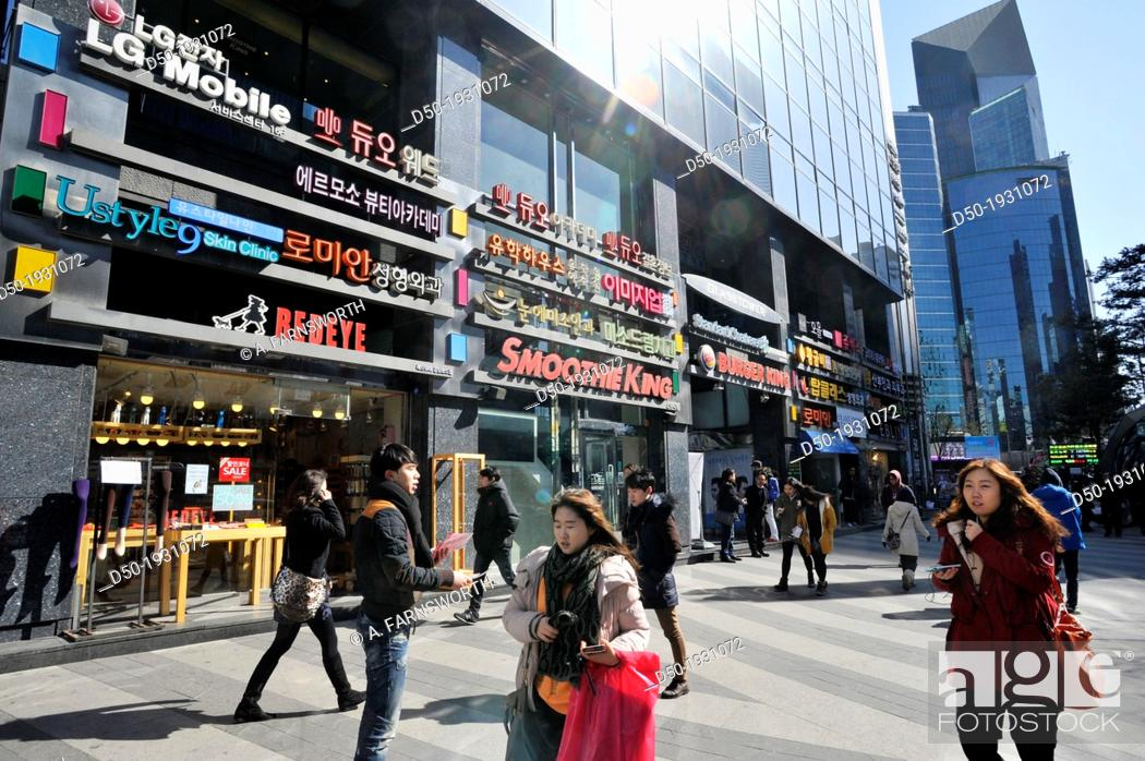 Stock Photo: SEOUL SOUTH KOREA Restaurants, signs and pedestrians in the downtown.