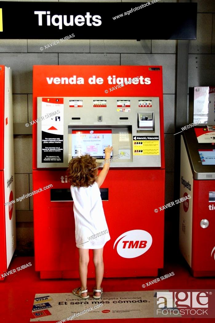 Stock Photo: 5 year old girl in front of ticket vending machine, Barcelona. Catalonia, Spain.