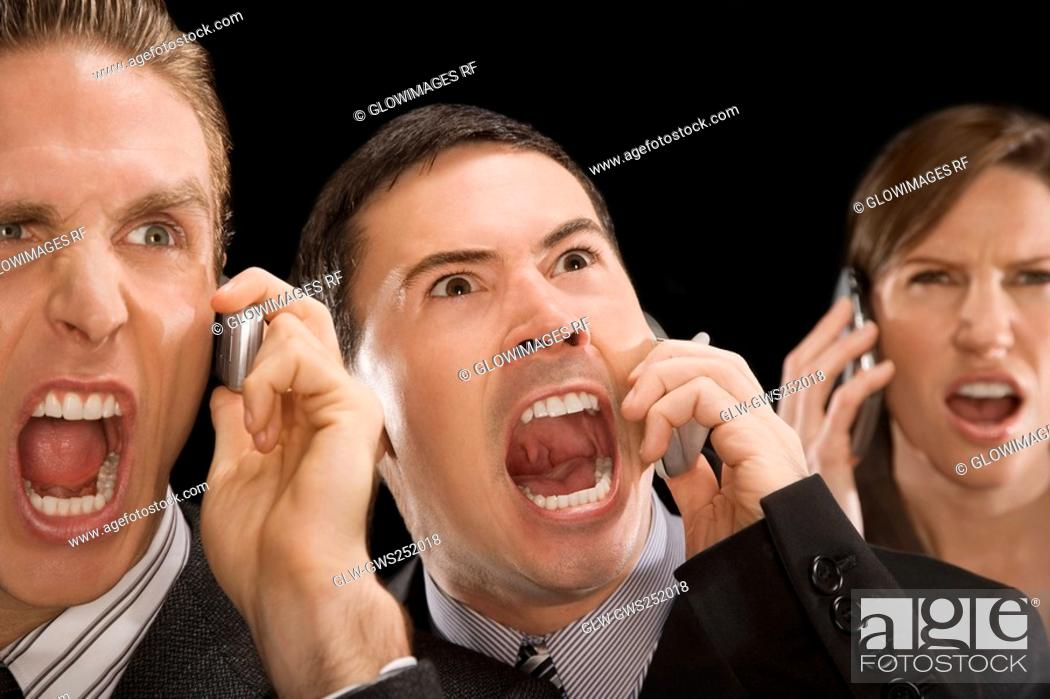 Stock Photo: Close-up of business executives shouting on a mobile phone.