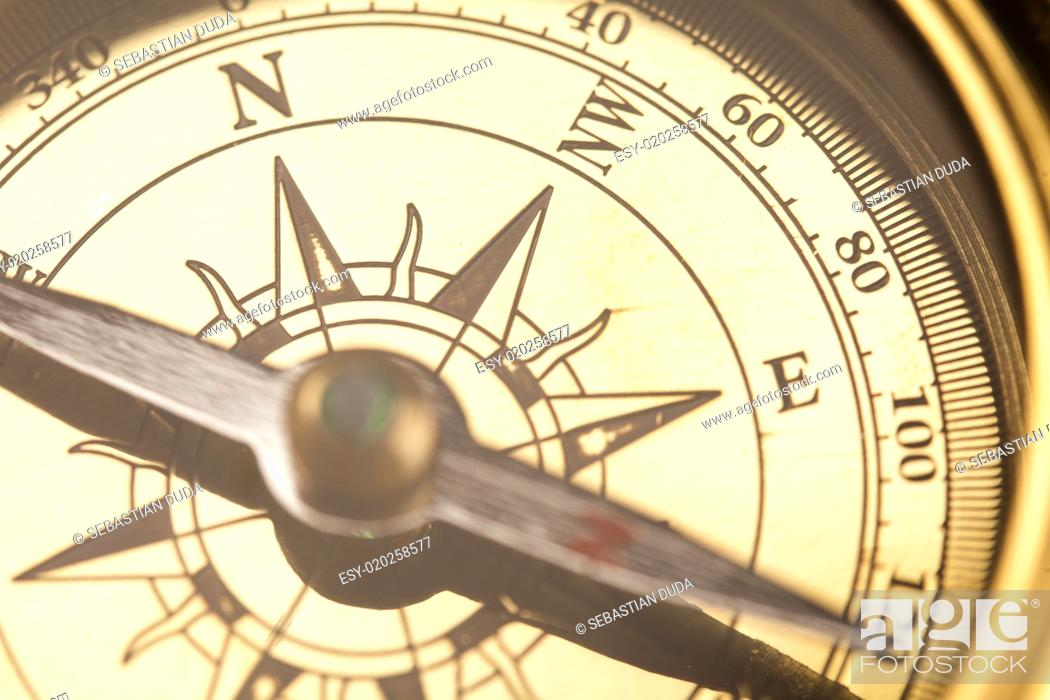 Imagen: Compass on old map.