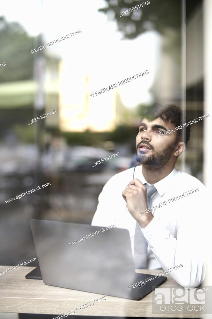 Stock Photo: businessman with laptop and idea.