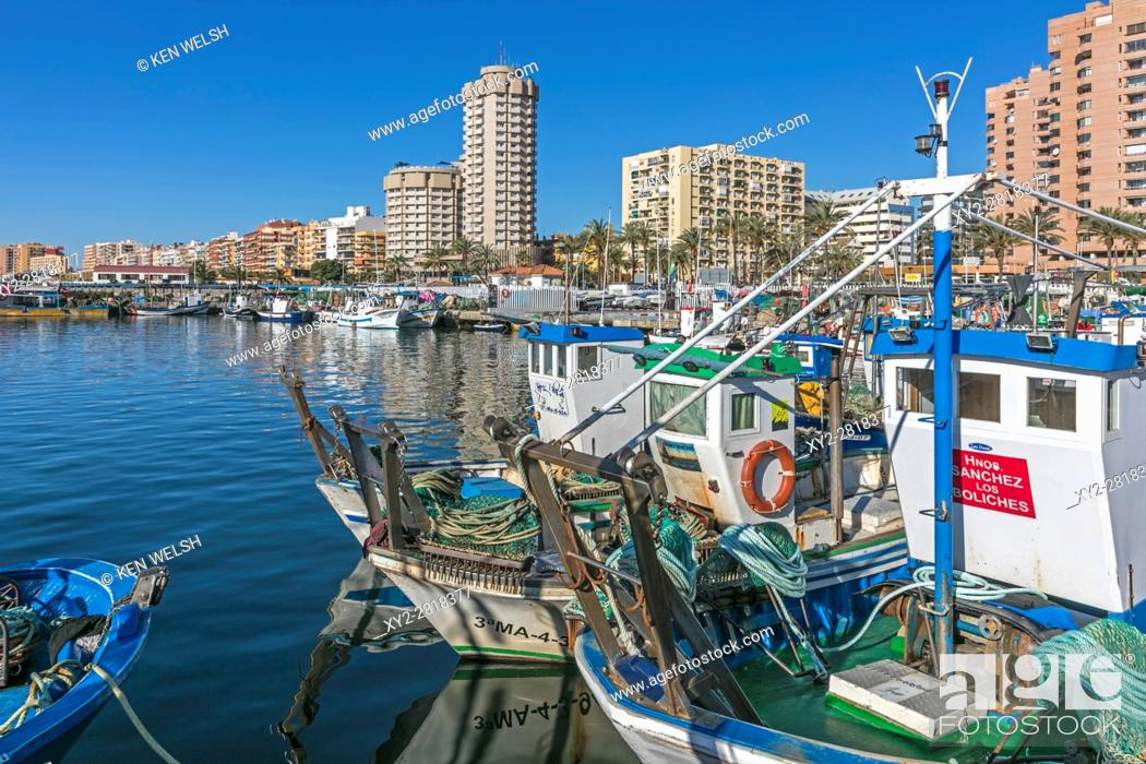 Stock Photo: Fuengirola, Costa del Sol, Malaga Province, Andalusia, southern Spain. Fishing boats in the port. Hotels and apartment blocks behind.