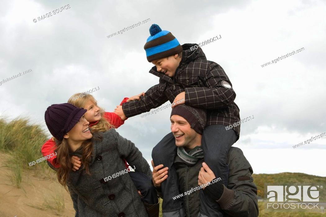 Stock Photo: Family at the coast.