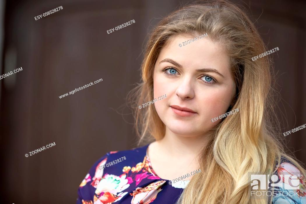Stock Photo: Portrait of a blonde girl with blue eyes. A girl with a European style face.