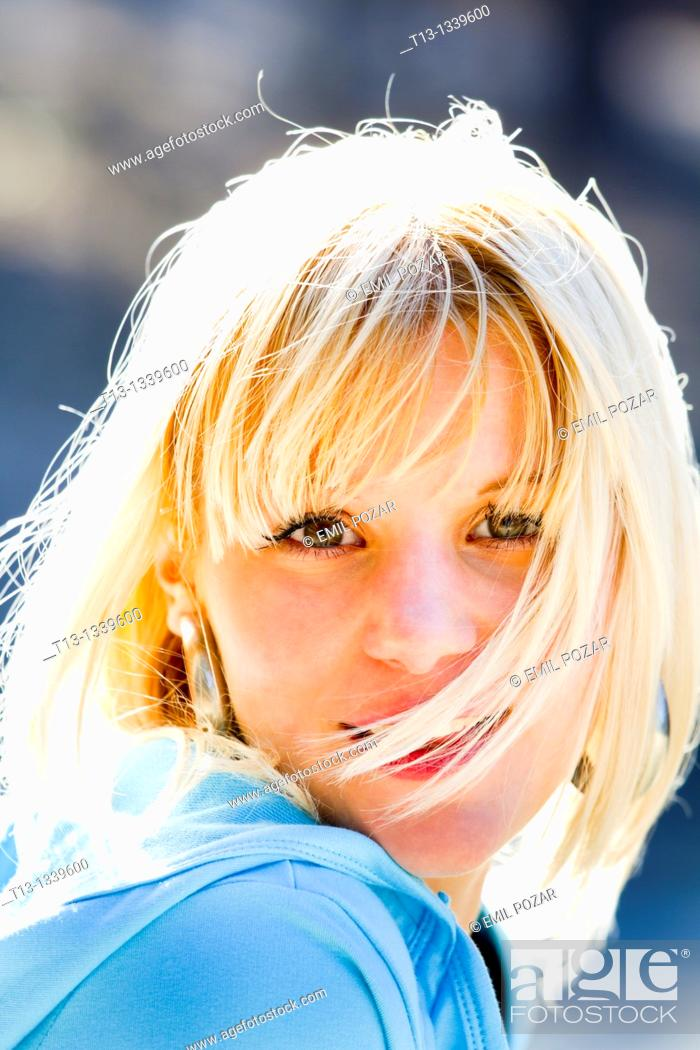 Stock Photo: Happy young woman face, blowing wind.