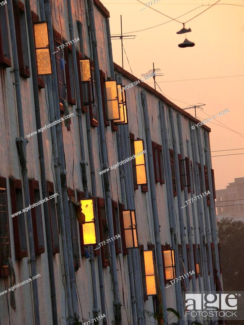 Stock Photo: Sunset light is reflected on glass finished window shutters of a residential building at Vadgaon Budruk  Pune, Maharashtra, India.