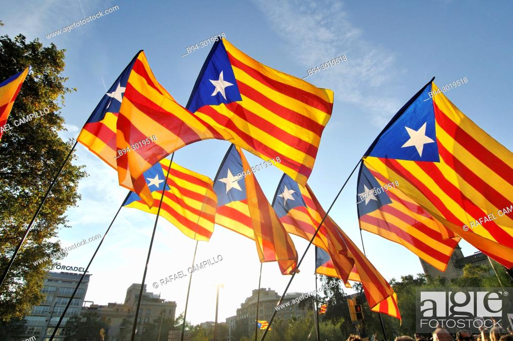 Stock Photo: Political demonstration for the independence of Catalonia. Estelades, Catalan independent flags. October 2017. Barcelona, Catalonia, Spain.