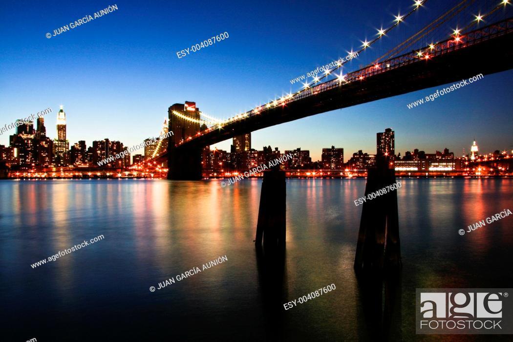 Stock Photo: The Brooklyn Bridge at night, New York City.